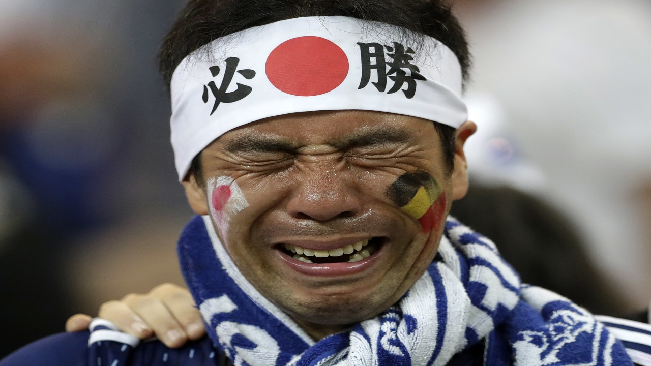 A Japan supporter cries after his team fell against Belgium in the round of 16 World Cup match in the Rostov Arena, in Rostov-on-Don, Russia, Monday, July 2, 2018. (AP Photo/Petr David Josek)