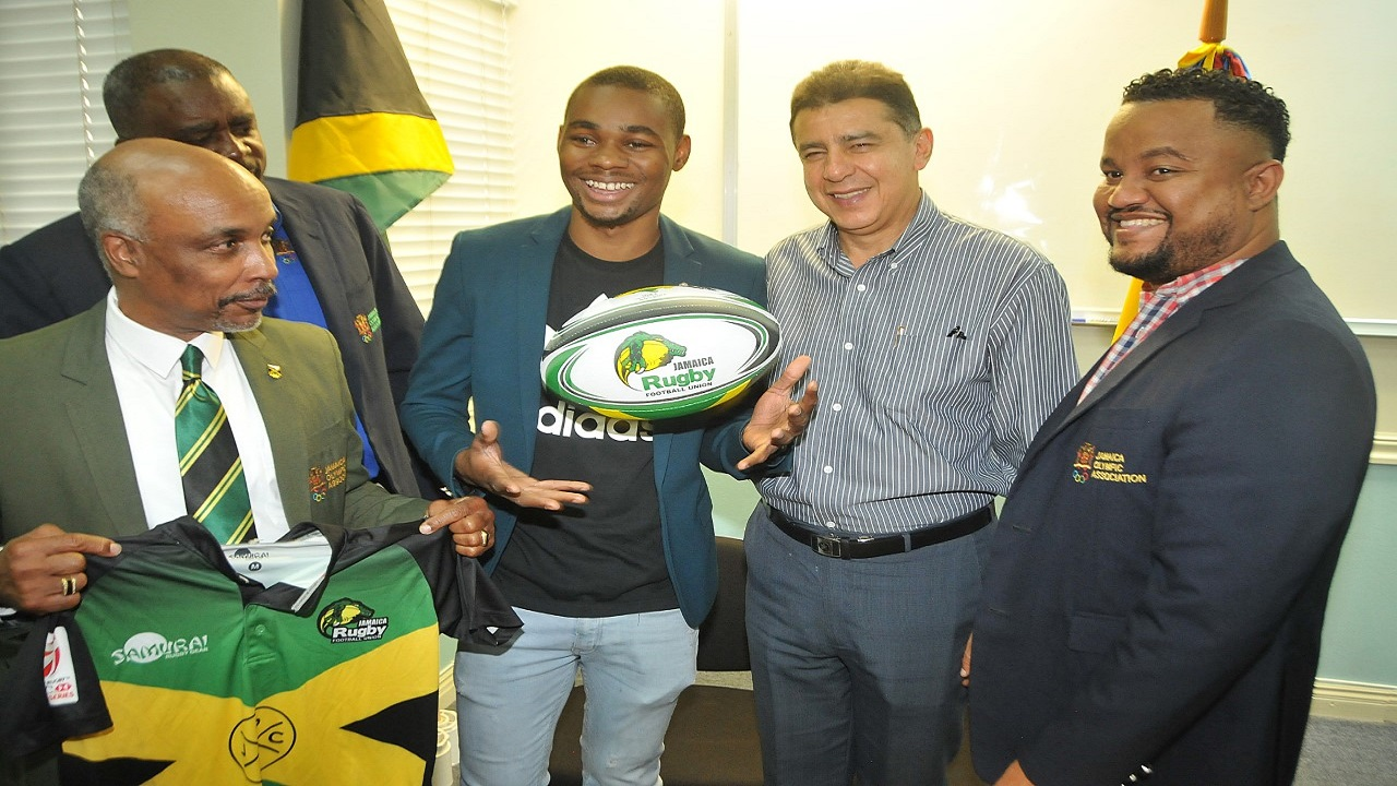 Christopher Samuda (left), President of the Jamaica Olympic Association (JOA), displays a shirt of Jamaica's senior men's rugby team as he stands alongside (from right) JOA's CEO, Ryan Foster, Roberto Garcia Marquez, Colombia's Ambassador to Jamaica, athlete Warren Weir and JOA Director, Raymond Anderson.  Occasion was the JOA press conference to name its team to the 23rd Central American and Caribbean Games, which will be held in Barranquilla, Colombia, from July 19-August 3.