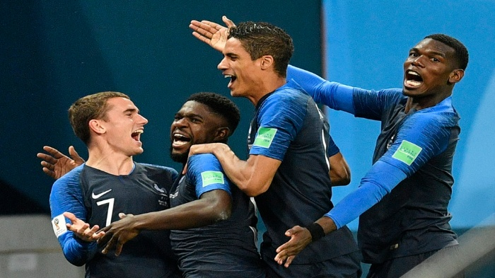 France's Samuel Umtiti, second from left, is congratulated by his teammates France's Antoine Griezmann, Raphael Varane and Paul Pogba, from left, after scoring the opening goal during the semifinal match between France and Belgium at the 2018 World Cup in Russia. Some French people are not pleased with the racial makeup of the team. (AP Photo/Martin Meissner)