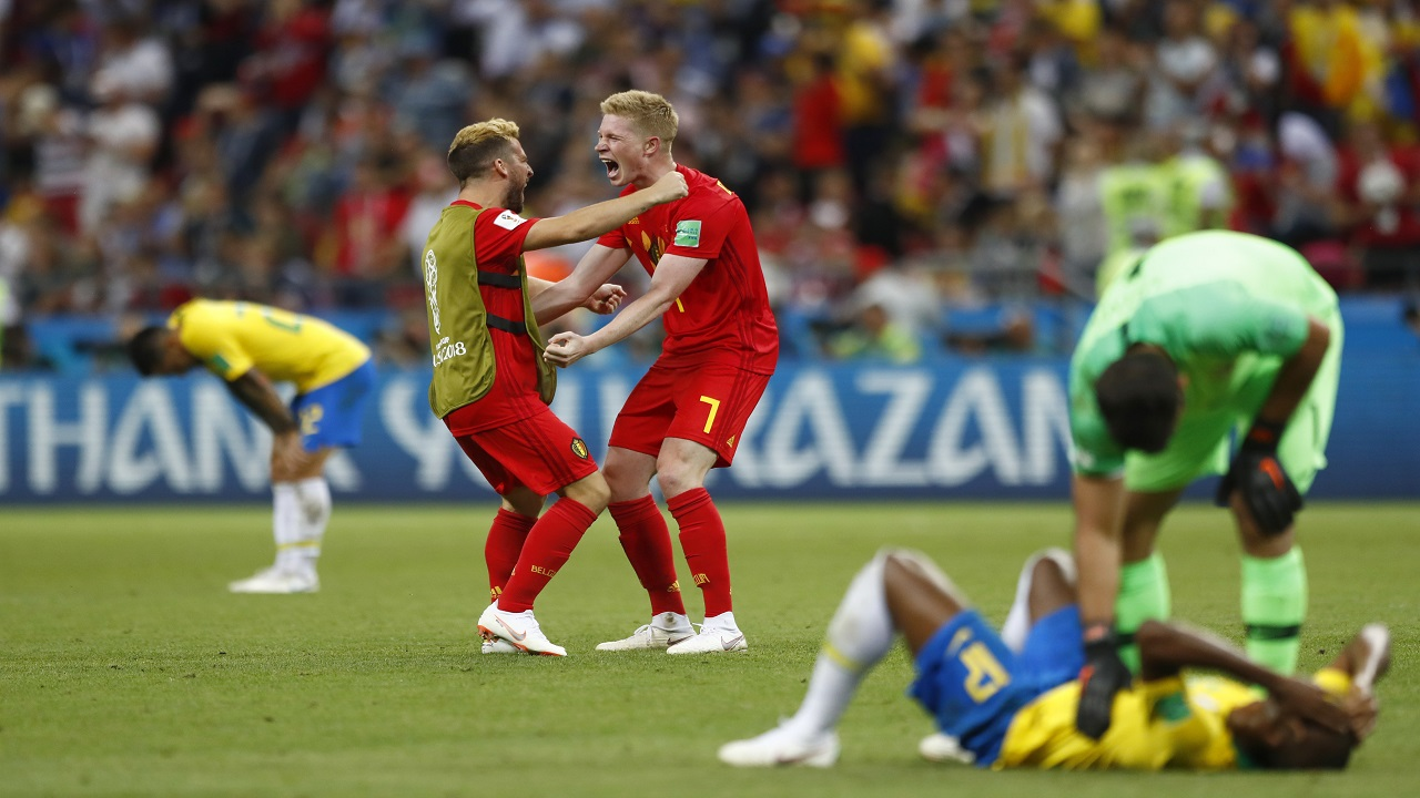 Belgium's Kevin De Bruyne (7) celebrates with one of his teammates after the final whistle as Belgium defeat Brazil in their quarterfinal match at the 2018 football World Cup in the Kazan Arena, in Kazan, Russia, Friday, July 6, 2018. Belgium won the game 2-1. (AP Photo/Matthias Schrader).