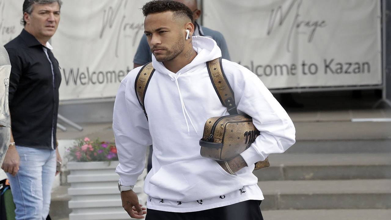 Brazil's Neymar leaves the hotel to board a bus in his way to the airport in Kazan, Russia, Saturday, July 7, 2018. Brazil lost the quarterfinal against Belgium and leave the football World Cup. (AP Photo/Andre Penner).