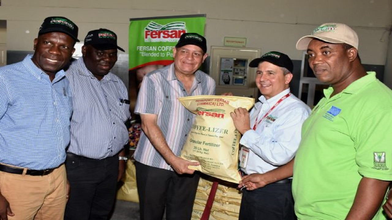 Minister of Agriculture, Audley Shaw (third left), receives a bag of coffee fertiliser from Managing Director, Newport-Fersan Jamaica (NFJ), Dennis Valdez (second right), at a symbolic handing-over at NFJ in Kingston on Friday. Also pictured (from left) are outgoing Jamaica Agricultural Society President, Norman Grant; Permanent Secretary in the ministry, Donovan Stanberry; and Chief Executive Officer, Rural Agricultural Development Authority (RADA), Peter Thompson.
