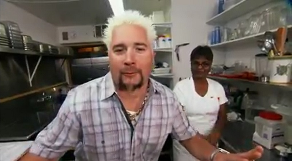 Photo: Guy Fieri of the Food Network visits Pam's Kitchen, a Trinbagonian restaurant based in Seattle. The restaurant is featured on Triple D Nation: Poke, Pork, and Chicken Parm in July 2018.