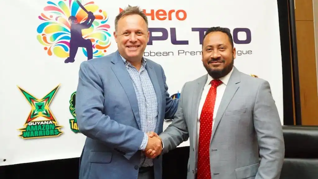 Pete Russell, COO of Hero CPL, and Ryan Ramjit, Guyana Country Manager, Repsol, sign league wide sponsorship deal for the 2018 tournament.