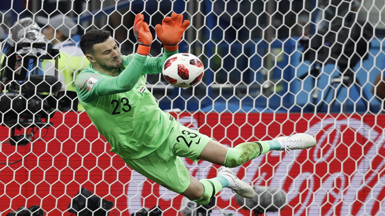 Croatia goalkeeper Danijel Subasic makes a save during a penalty shoot out after extra time during the round of 16 match against Denmark at the 2018 football World Cup in the Nizhny Novgorod Stadium, in Nizhny Novgorod , Russia, Sunday, July 1, 2018. (AP Photo/Efrem Lukatsky)