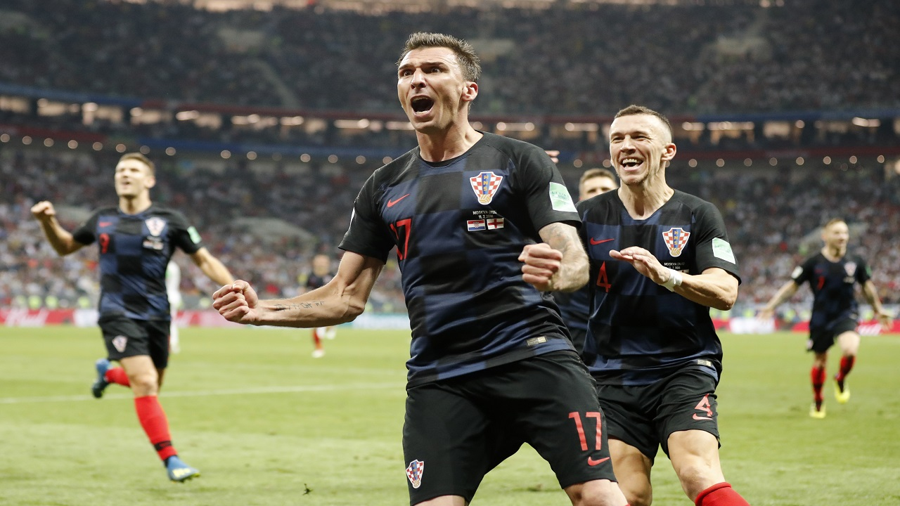 Croatia's Mario Mandzukic celebrates after scoring his side's second goal during the semifinal match against England at the 2018 football World Cup in the Luzhniki Stadium in Moscow, Russia, Wednesday, July 11, 2018. (AP Photo/Frank Augstein).