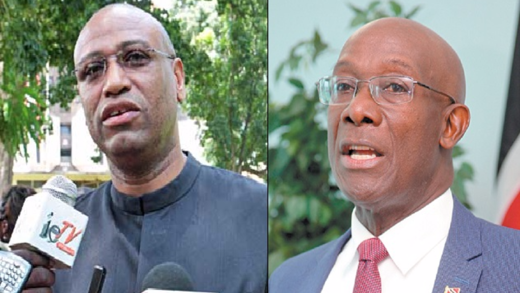 Joint Trade Union Leader (JTUM) Ancel Roget (left), Prime Minister Dr Keith Rowley (right).