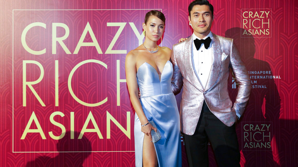 "Actor Henry Golding and his wife Liv Lo pose as they arrive for the red carpet screening of the movie ""Crazy Rich Asians"" on Tuesday, Aug. 21, 2018, in Singapore. (AP Photo/Don Wong)"