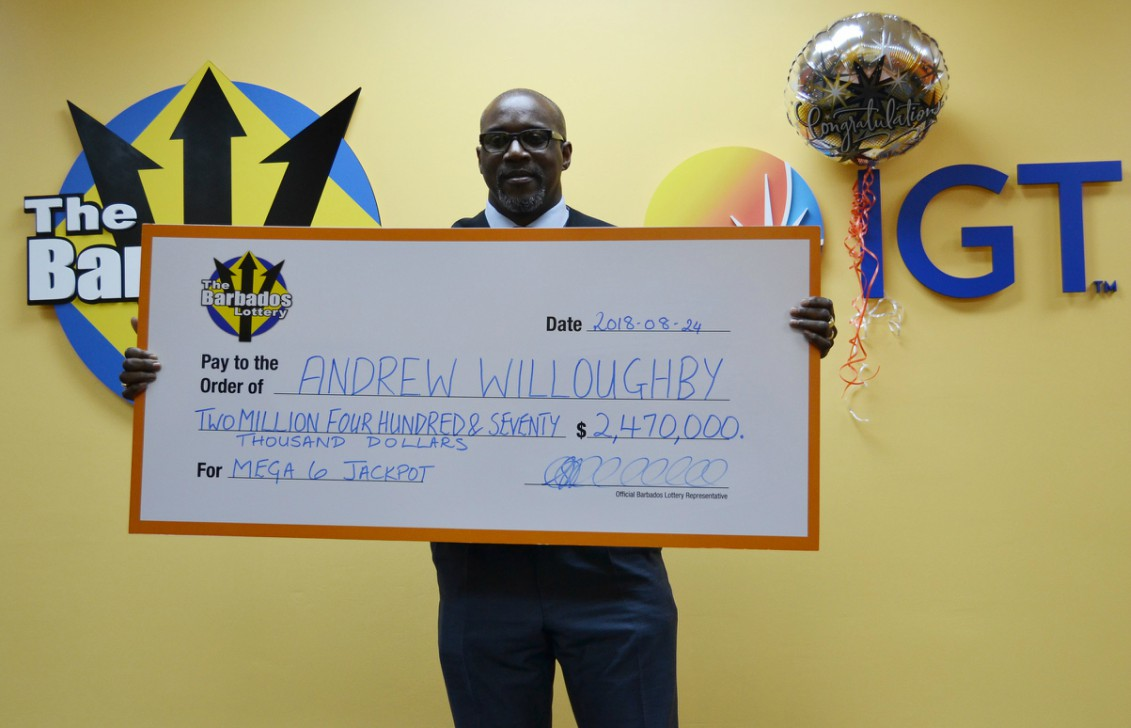 Andrew Willoughby, accepting the winnings on behalf of his client- the winner of the August 16, 2018 Mega 6 Jackpot.