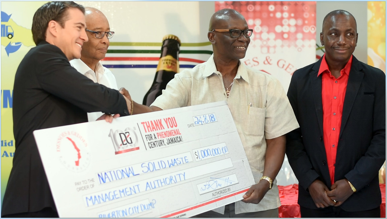 Managing Director of Red Stripe, Ricardo Nuncio (left), hands Minister of Local Government, Desmond McKenzie (second right), the symbolic cheque of $1 million that the Desnoes and Geddes Foundation presented to the National Solid Waste Management Authority (NSWMA) on Friday. The money will go towards the purchase of cameras to be installed at the Riverton landfill in St Andrew. Also pictured (l-r) are Noel daCosta, Chairman of D&G Foundation, and Audley Gordon, Executive Director of the NSWMA.