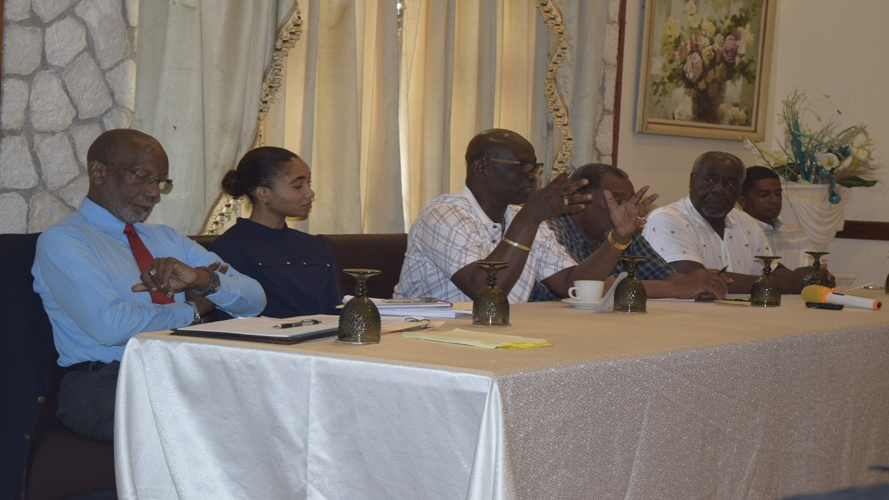 Local Government Minister Desmond McKenzie (centre) makes a point during a meeting with stakeholders in Negril.