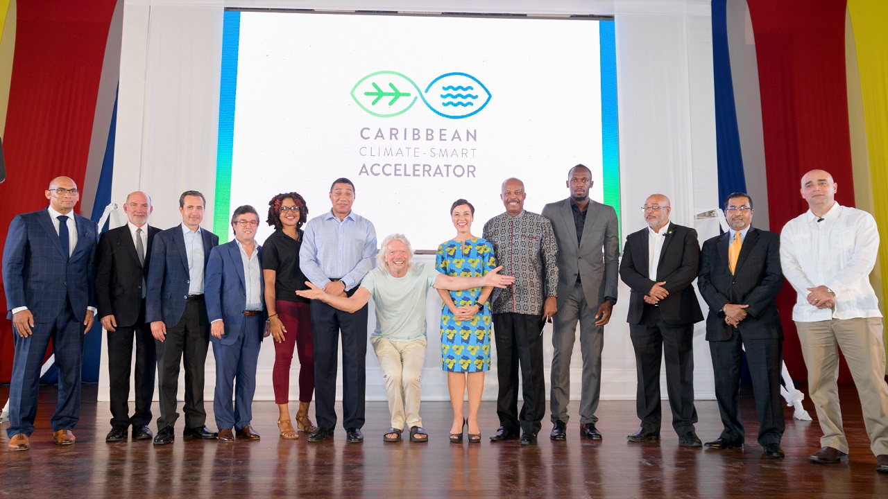 Stakeholders and government members including Prime Minister Andrew Holness and Sir Richard Branson at the launch of the climate change accelerator on Thursday.