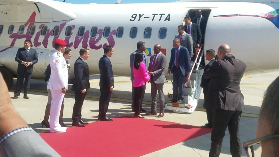 Prime Minister Dr. Keith Rowley arrives in Venezuela for the signing of the historic gas deal