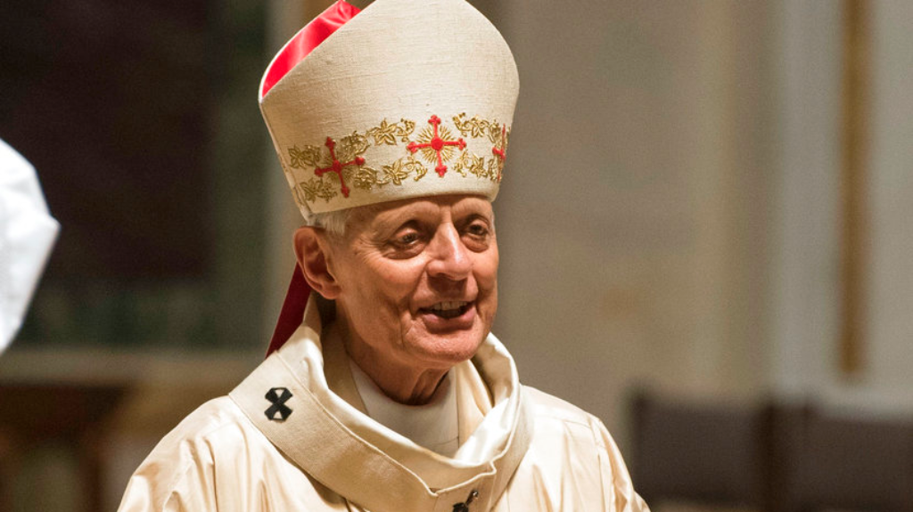 Cardinal Donald Wuerl, Archbishop of Washington, conducts Mass at St. Mathews Cathedral, Wednesday, August 15, 2018 in Washington. (AP Photo/Kevin Wolf)
