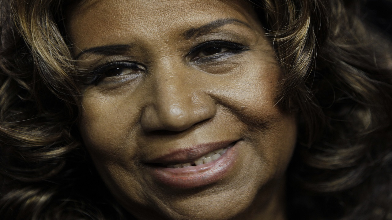 In this February 11, 2011 file photo, Aretha Franklin smiles after the Detroit Pistons-Miami Heat NBA basketball game in Auburn Hills, Michigan. (AP Photo/Paul Sancya, File)