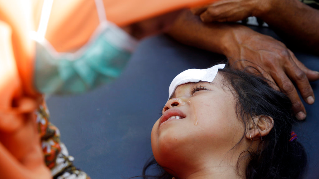 A girl injured in an earthquake is treated in Mataram, Lombok, Indonesia, Thursday, Aug. 9, 2018. The Indonesian island of Lombok was shaken by a third big earthquake in little more than a week Thursday. (AP Photo/Firdia Lisnawati) .