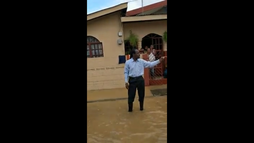 Photo: Video footage of MP Fitzgerald Hinds being splashed by disgruntled residents in Beetham circulated online on Tuesday night. Image taken from Facebook.