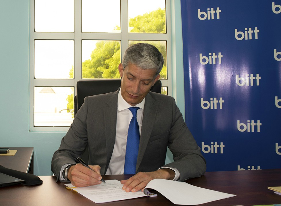 Rawdon Adams, Bitt CEO as he signs the UWI Memorandum of Understanding.