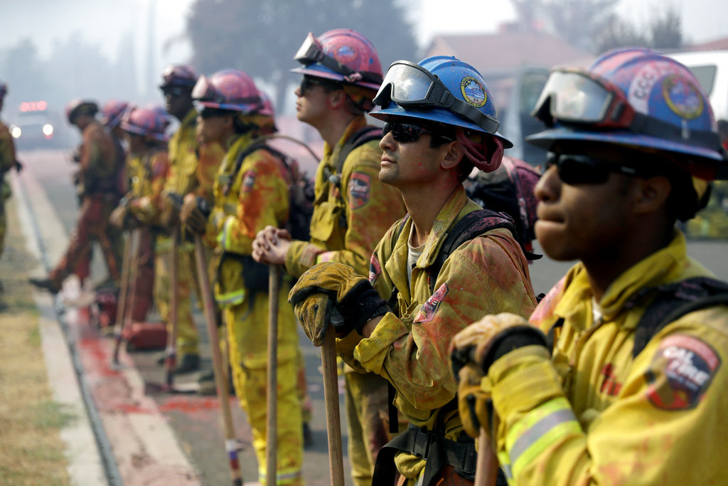 Fire crews line up as they watch a wildfire on a ridge top while protecting a residential area Friday, Aug. 10, 2018, in Lake Elsinore, Calif. (AP Photo/Marcio Jose Sanchez)