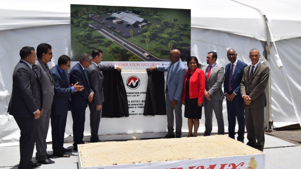 Prime Minister Dr Keith Rowley and Shameer Ronnie Mohammed, Nutrimix Director unveil the foundation stone for the Nutrimix's Next Generation Hatchery.