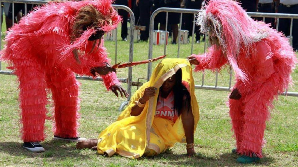Photo: A woman wears a yellow sari in a PNM family day skit on August 12, 2018. The sari is ripped away to reveal a PNM t-shirt underneath. Some have called the skit insulting.
