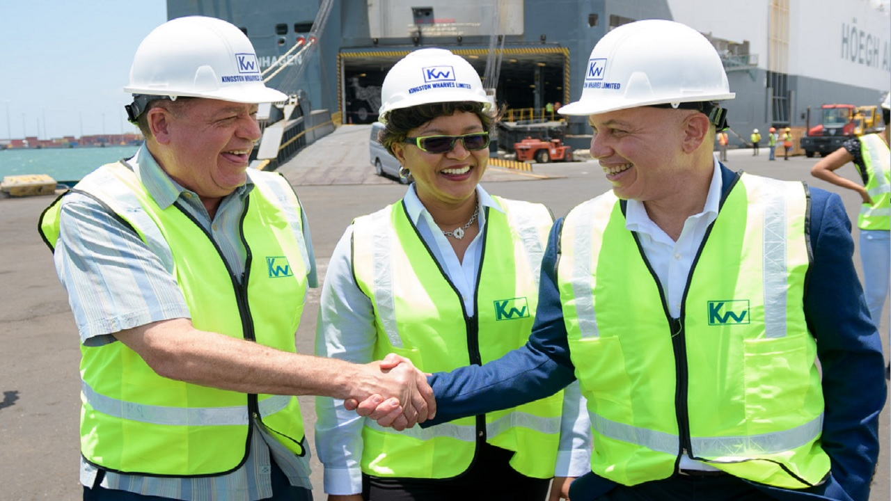 Industry Minister Audley Shaw (left) with Clover Moore (centre) CFO Kingston Wharves Limited and Jeffrey Hall (right) CEO JP Group as they tour the Kingston Wharves Auto Transhipment facility.