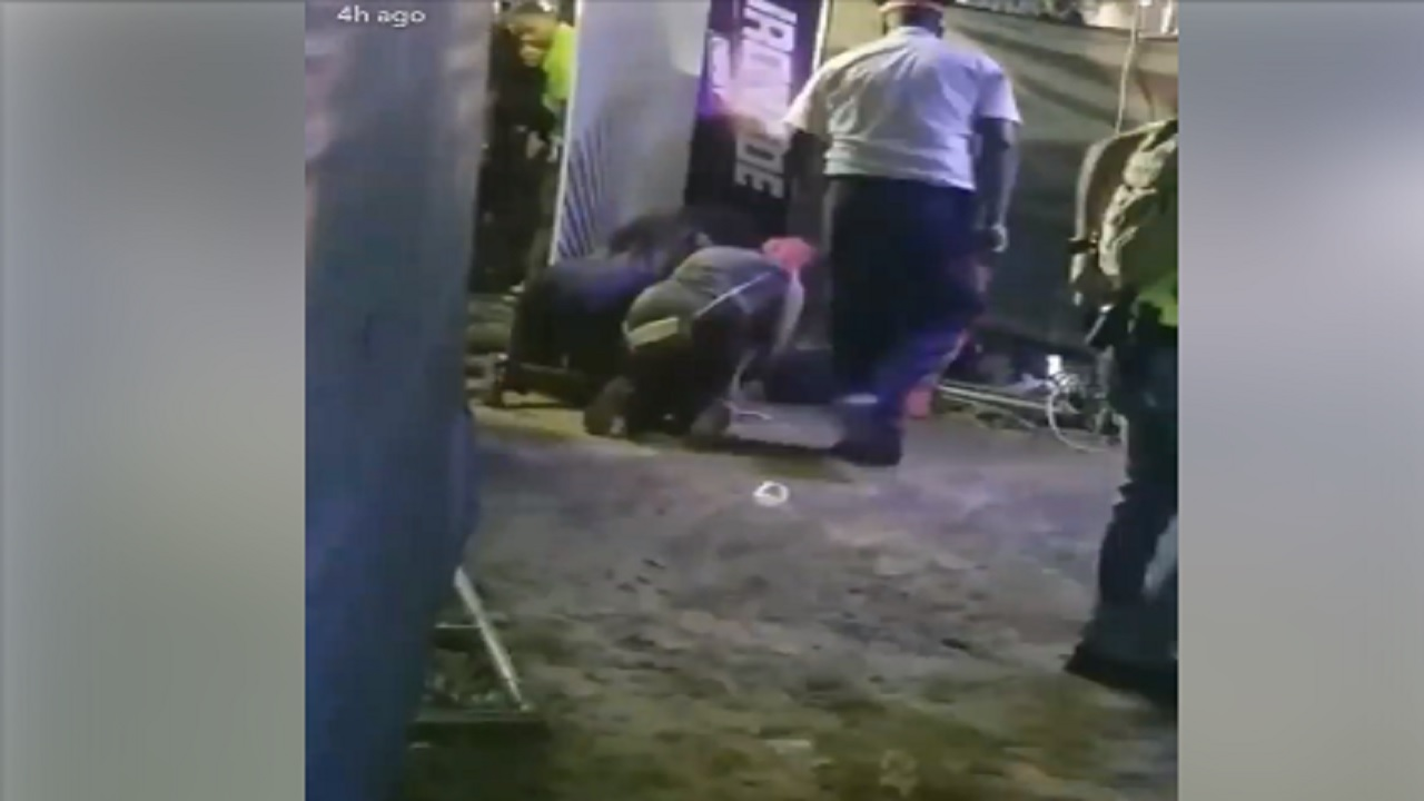 Screenshot of a video showing women attending to the gunshot victim at the party.