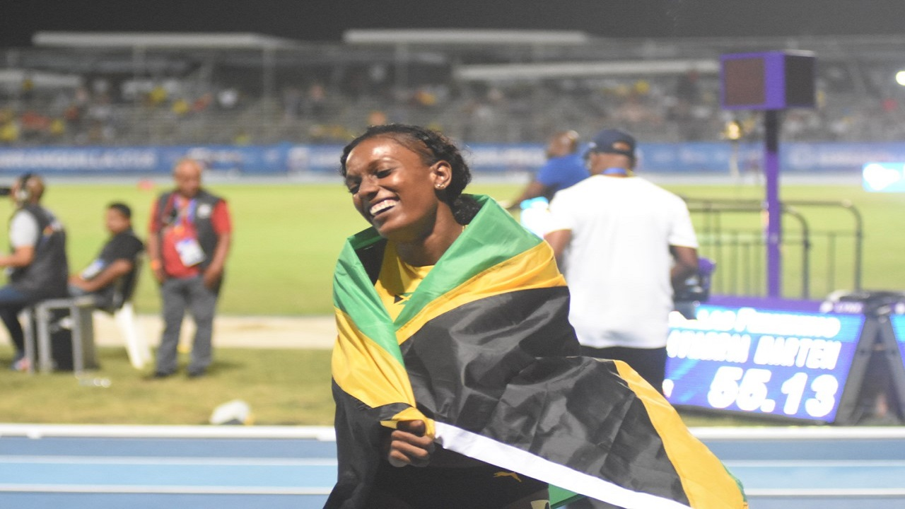 Jamaica's Rhonda Whyte celebrates winning the women's 400m hurdles final at the 23rd Central American and Caribbean Games in Barranquilla, Colombia, on Tuesday night.