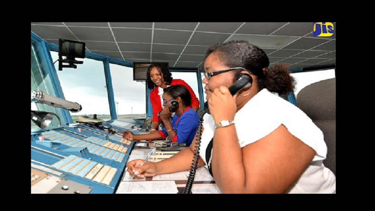 An all-female crew in the Sangster International Airport Air Traffic Control Tower, in St. James. Former Chief Air Traffic Controller, Karen Green (centre), is surrounded by Air Traffic Controllers (from left): Anna-Kay Elliott, Allison McIntosh, Shanique Malcolm and Deidre Shaw. Photo via Jamaica Information Service.