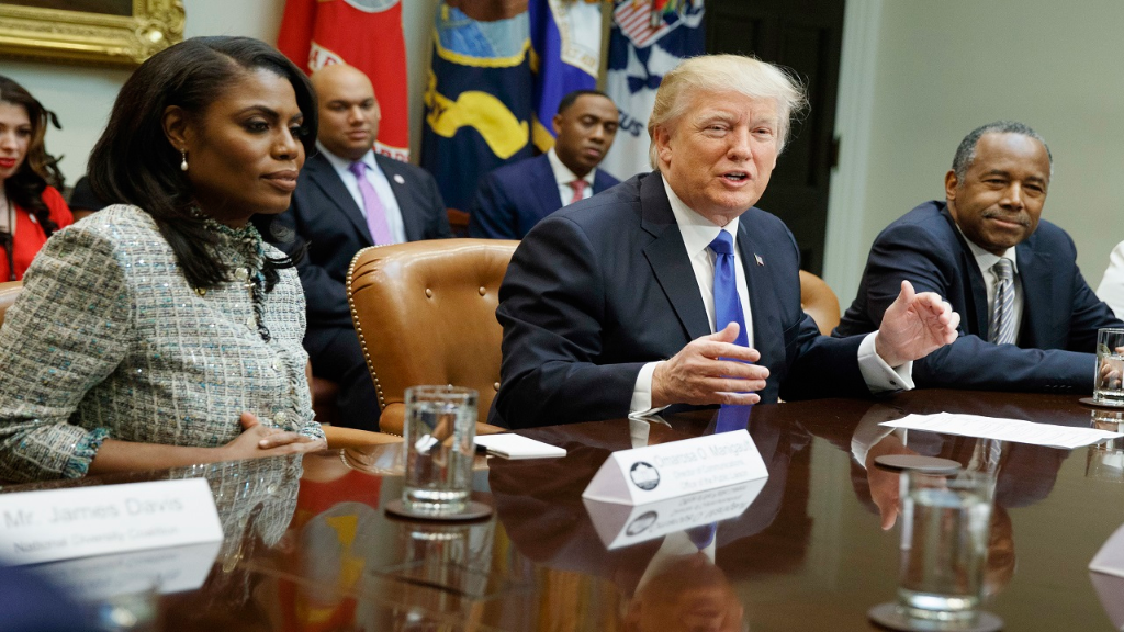"In this Feb. 1, 2017, file photo, President Donald Trump speaks during a meeting on African American History Month in the Roosevelt Room of the White House in Washington. From left are, Omarosa Manigault, Trump, and then-Housing and Urban Development Secretary-designate Ben Carson. Omarosa Manigault Newman — the former ""Apprentice"" contestant who became one of Trump's most prominent African -American supporters — has resigned from the White House."
