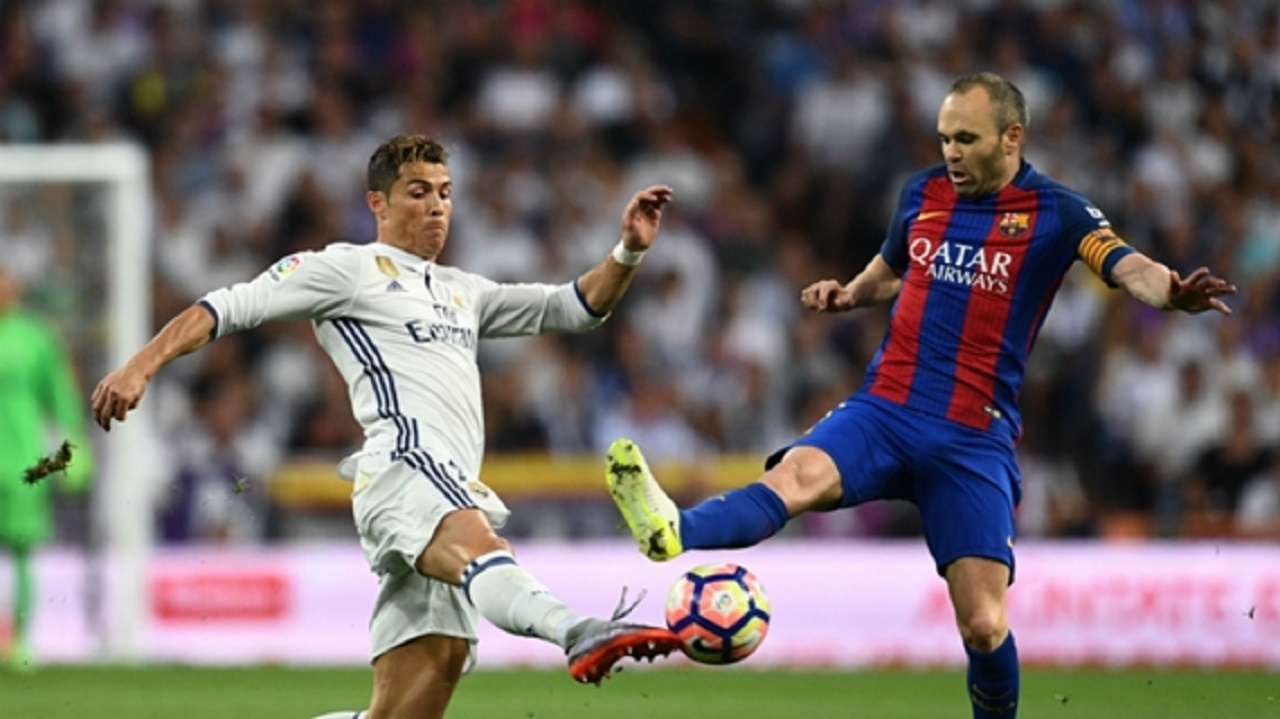 Cristiano Ronaldo (left) and Andres Iniesta.