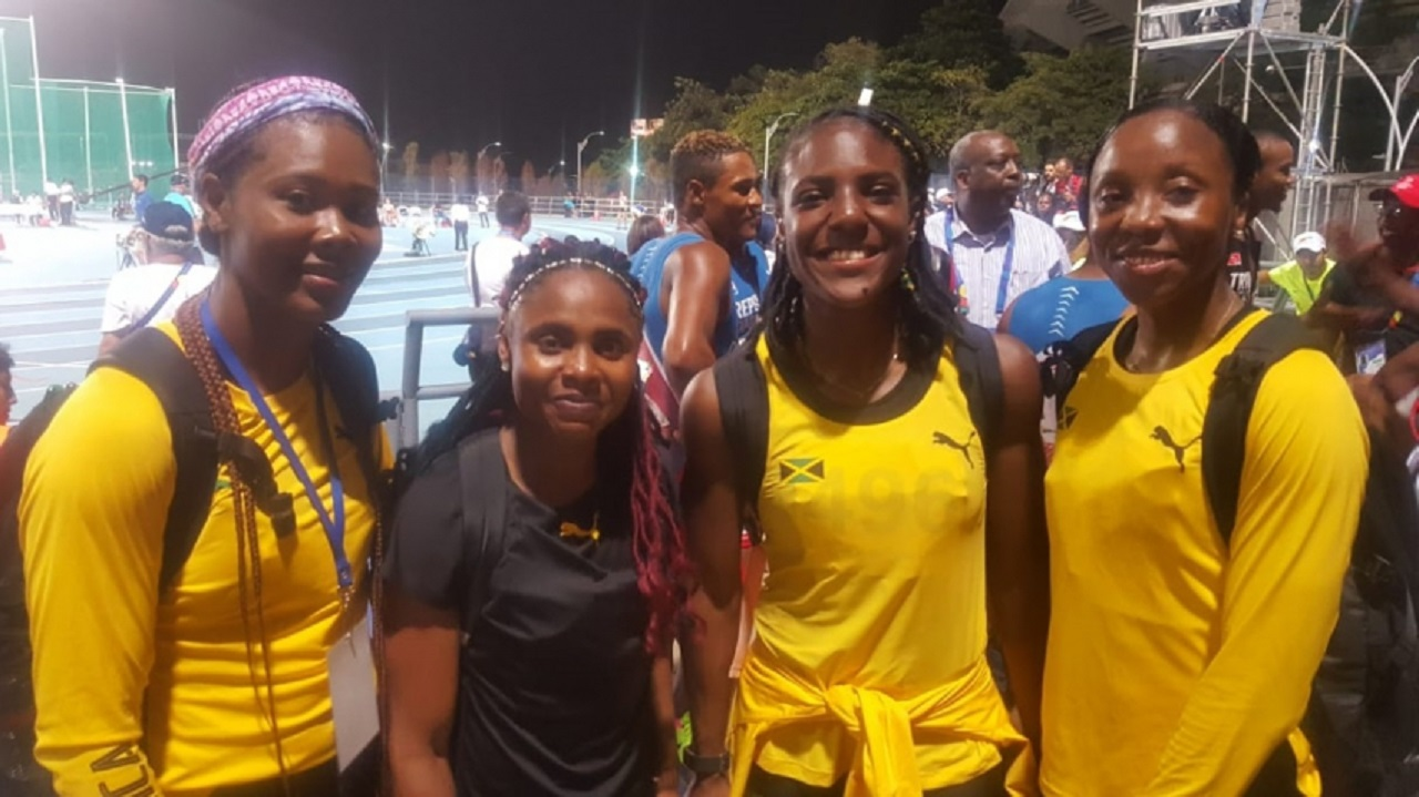 Nastasha Morrison, Jura Levy, Jonielle Smith and Sherone Simpson pose for a picture after winning the women's 4x100m gold medal at the CAC Games in Colombia on Thursday night.