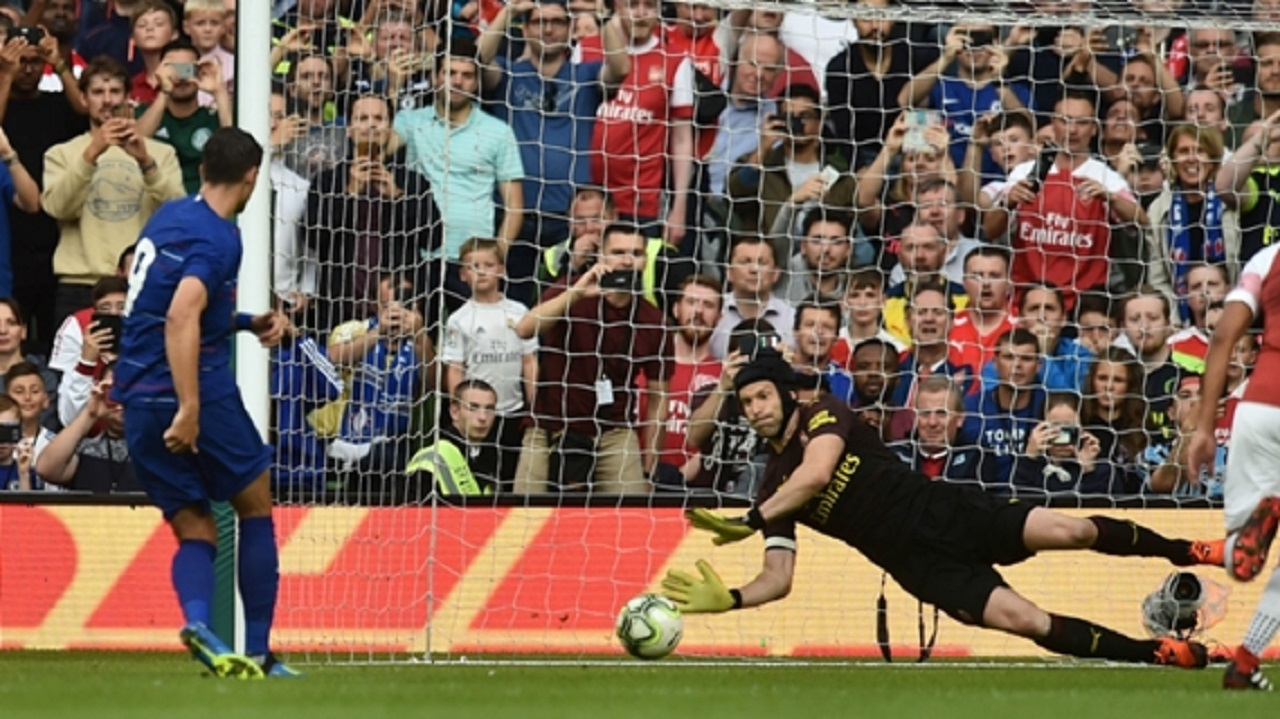 Petr Cech saves Alvaro Morata's penalty.