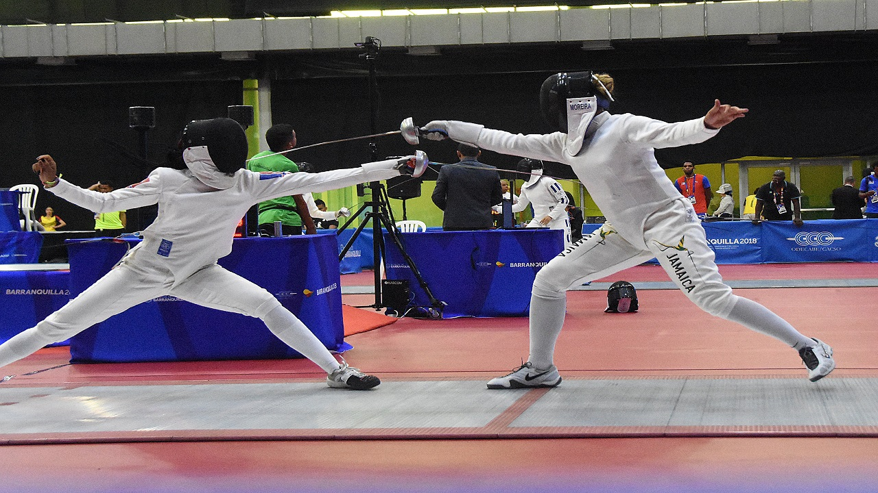 Caitlin Chang (left) participating in the semi-finals of the women's epee fencing competition against fellow Jamaican Caira Moreira-Brown. Chang won the match 15-9.