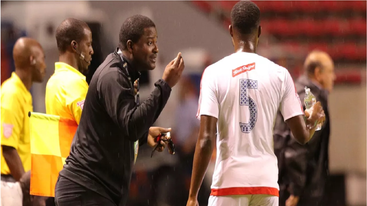 Portmore United´s Head Coach Shavar Thomas (left) giving instructions to Ryan Wellington during the first leg game for the round of 16 of the Scotiabank Concacaf League against Santos de Guapiles at Estadio Nacional in San Jose, Costa Rica on August 1, 2018. (PHOTO: Concacaf).