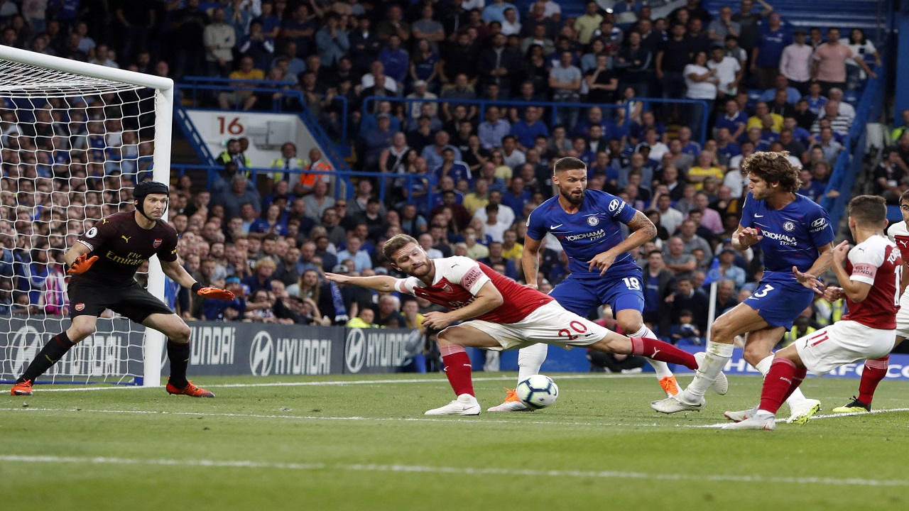 Chelsea's Marcos Alonso, second right, scores his side's third goal during the English Premier League football match against Arsenal at Stamford bridge stadium in London, Saturday, Aug. 18, 2018.