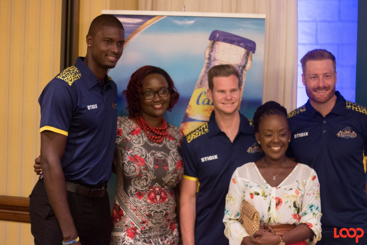 Captain Jason Holder, Steve Smith and Martin Guptill with sponsors at the mingle held on Friday, at Hilton Barbados.