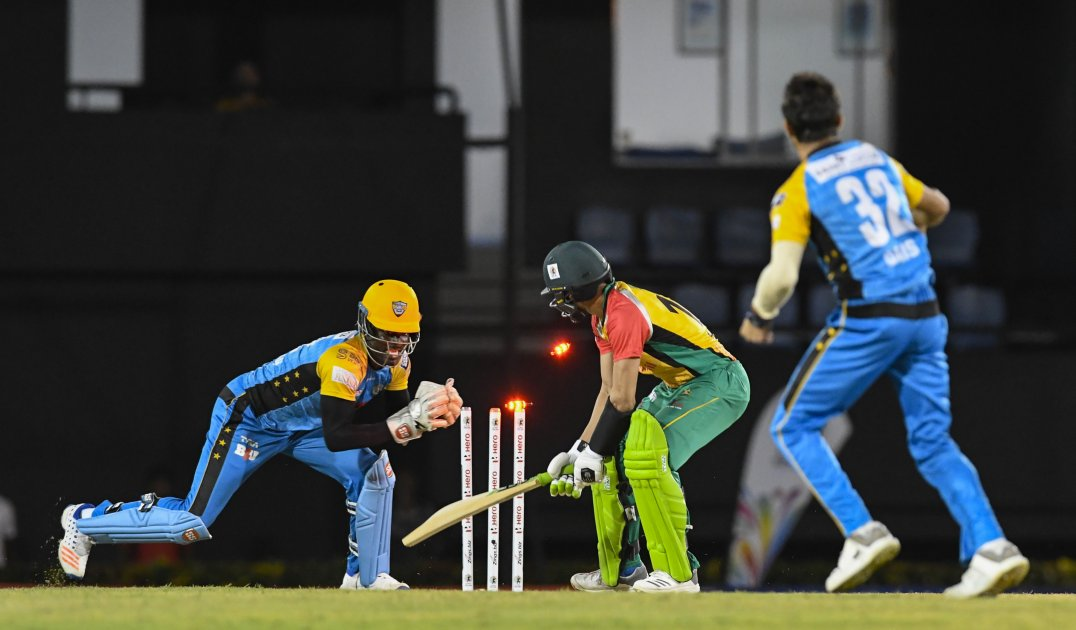 Andre Fletcher (left) attempts a stumping during St Lucia Stars's victory over Guyana Amazon Warriors (Photo courtesy CPL T20 Ltd.2018)