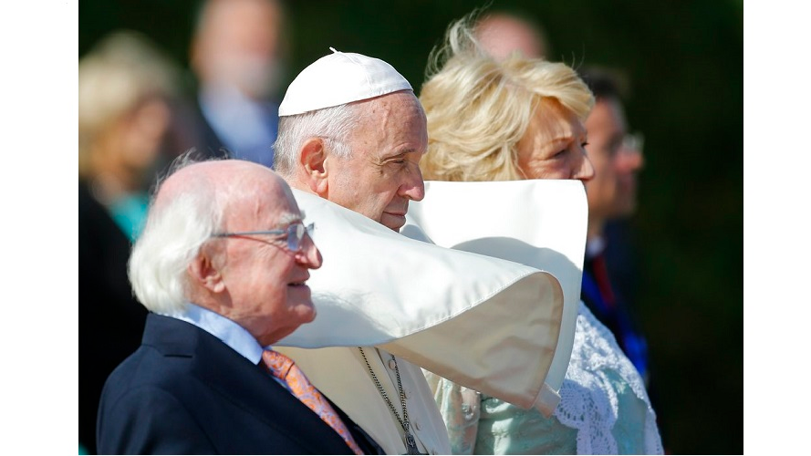 Pope Francis, center, is flanked by Irish President Michael D. Higgins, left, and President's wife Sabina, upon his arrival at the Presidential residence in Dublin, Ireland, Saturday, Aug. 25, 2018. Pope Francis is on a two-day visit to Ireland.
