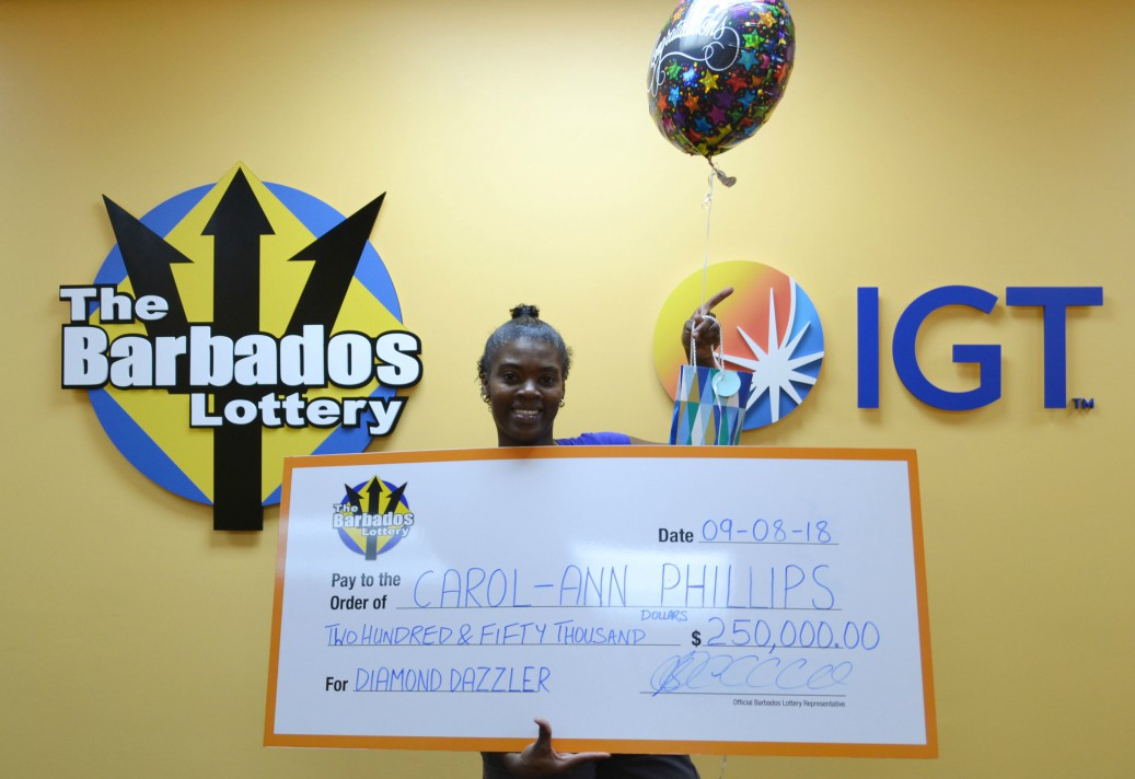 Carol-Ann Phillips gives a dazzling smile as she poses with her $250,000 cheque after winning the top prize for Diamond Dazzlers in a recent Barbados Lottery Scratch and Win Game after purchasing a $20 ticket.