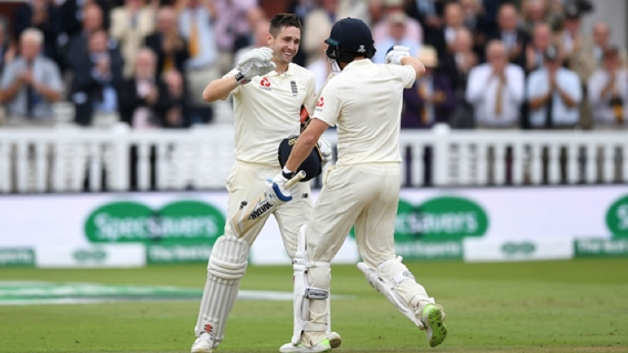 Chris Woakes celebrates his century with Jonny Bairstow.