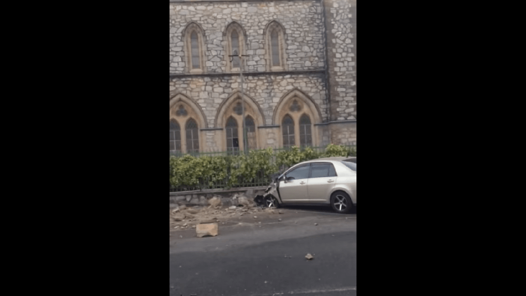 Rubble falls and damages car parked at Trinity Cathedral, located at Hart Street.