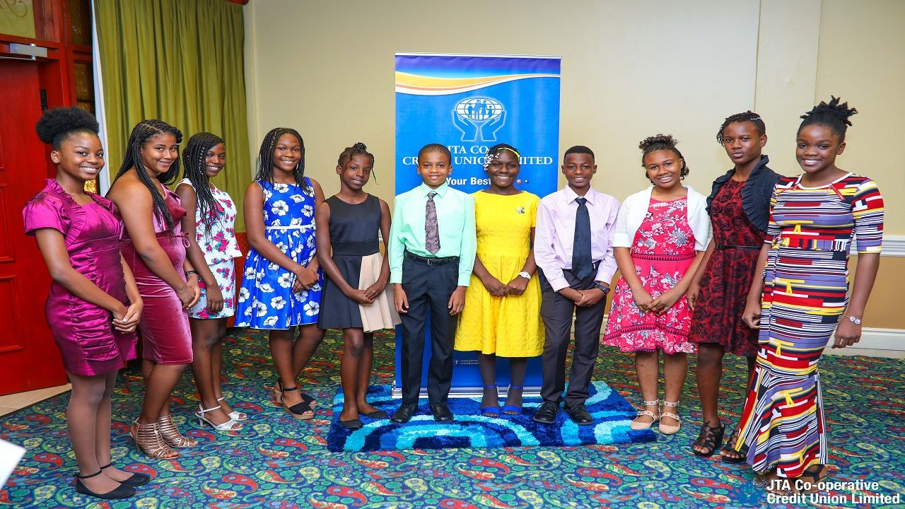 From left: JTA Co-operative Credit Union (JTACCU) bursary recipients Brianna Walters, Lorell Duncan, Mercedes Watson, Savanna Manning, Abilee Rodney, Deandre Wellington, Jhonelle Anderson, Carl Smith, Haeli Golding, Adronae Wilson and Shenelle McLeod all smile as they pose for a photo opportunity at the JTACCU Annual GSAT Bursary Awards ceremony.