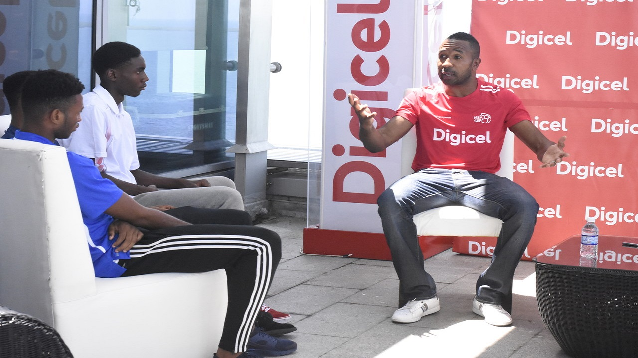 Former Jamaica international Ricardo Fuller speaks at a leadership and mentorship clinic at Digicel headquarters in downtown Kingston on Thursday. (PHOTO: Marlon Reid).
