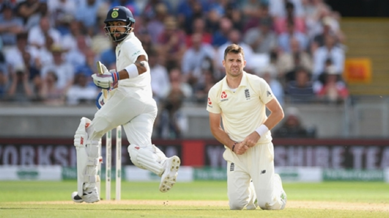 James Anderson looks on as Virat Kohli scores runs.