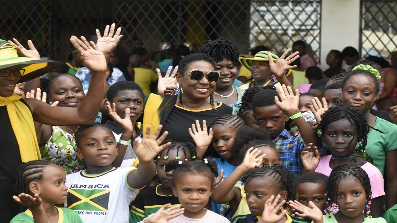 Culture Minister Olivia Grange is surrounded by children at the opening of the 2018  Independence Festival Village on Wednesday. (PHOTOS: Marlon Reid)