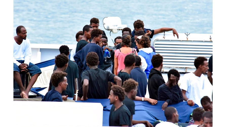 Migrants aboard the Italian Coast Guard ship Diciotti gather as they await decisions in the port of Catania, Italy, Friday, Aug. 24 2018.