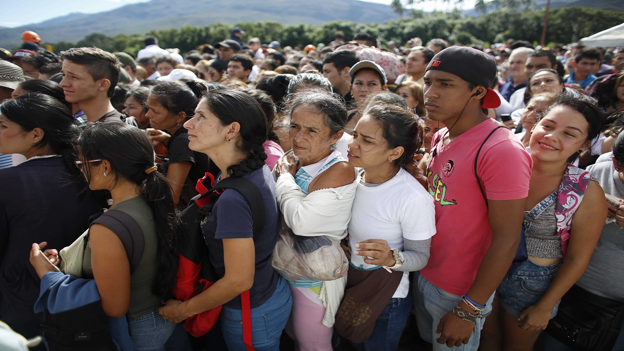 In this July 17, 2016 file photo, Venezuelans wait in line to cross into Colombia through the Simon Bolivar bridge in San Antonio del Tachira, Venezuela. The United Nations says an estimated 2.3 million Venezuelans had fled the country as of June 2018, mainly to Colombia, Ecuador, Peru and Brazil. (AP Photo/Ariana Cubillos, File)