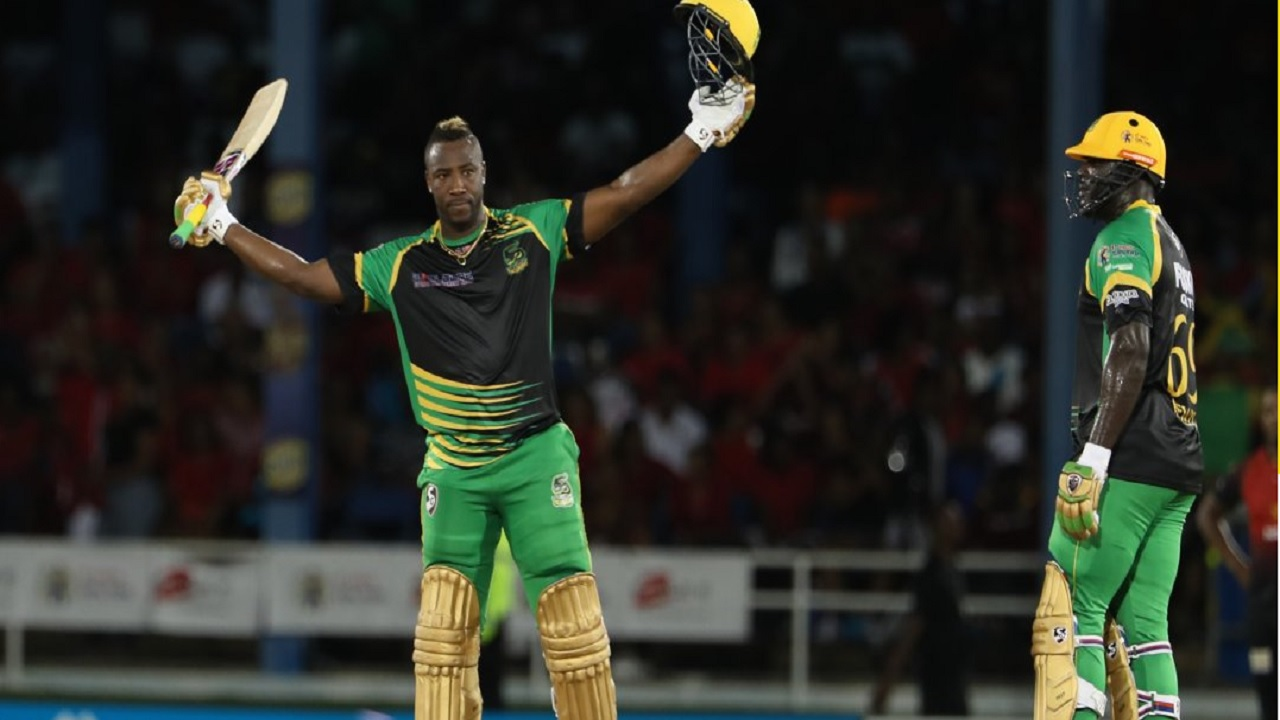 Andre Russell celebrates his century.