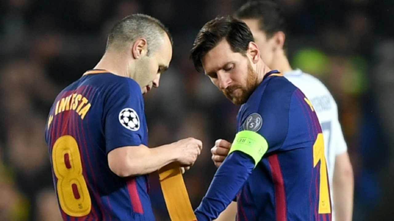 Andres Iniesta and Lionel Messi.
